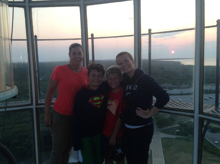family posing at the top of the Montauk Lighthouse at Sunset, Long Island, New York