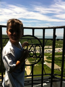 boy on the balcony at Montauk Lighthouse overlooking state park, Long Island