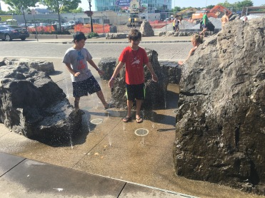 two boys having fun with street park, water spouts, Niagara, New York