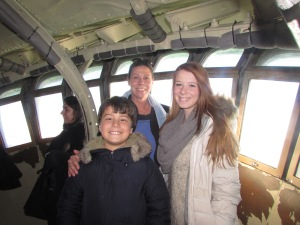 Family posing inside the Crown of the Statue of Liberty