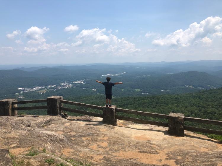 Man at Blue Ridge Mountain overlook at Black Rock Mountain State Park, Georgia