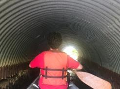 Canoeing inside tunnel, Peconic River, Long Island, New York