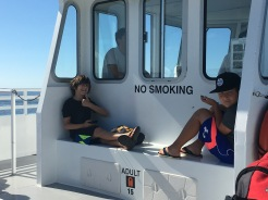 two boys on the ferry to Fire Island