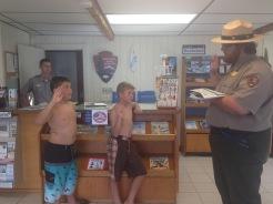 two boys being sworn in as Junior rangers, Fire Island national Seashore
