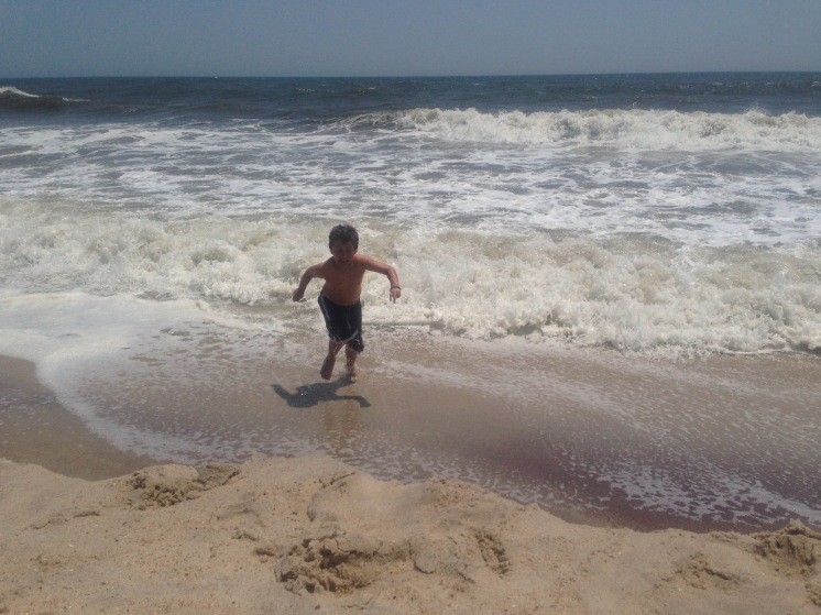 boy running out of ocean at Sailor's Haven, Fire Island