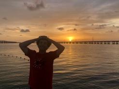 Boy smiling at sunset