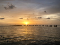 Sun setting over US1 across the water of Bahia Honda State Park, Florida