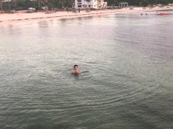 Boy swimming at the beach of Bahia Honda State Park, Florida