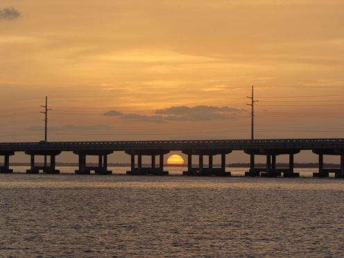 Orange sunset behind US1 across the bay of Bahia Honda State Park, Florida