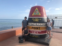 Family posing with Southernmost Point Marker in Key West, Florida