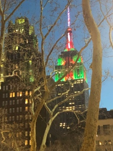 Empire State Building lit up for Christmas red and green