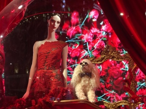 Lady and her dog red theme holiday window display at Saks Fifth Avenue NYC