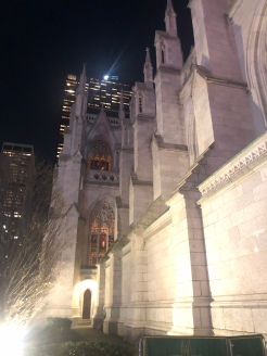 Street view of the side of St. Patrick's Cathedral NYC at night