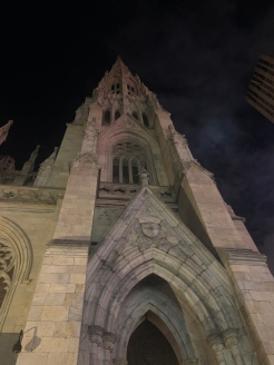 View up from the entrance at St. Patrick's Cathedral large Spire at night