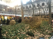 Bryant Park winter village landscape decorated with lights for the holiday