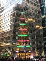 7 Bryant Park office building lit for the holidays red and green