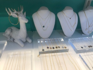 Jewelry display from local artisan at Bryant Park Winter Village shopping kiosk