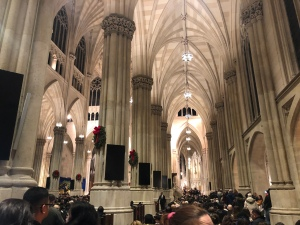 Inside St. Patrick's Cathedral view with white marble columns and cathedral ceiling at mass