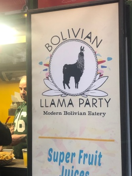 Sign for the Bolivian LLama Party food kiosk in NYC Winter Village at Bryant Park