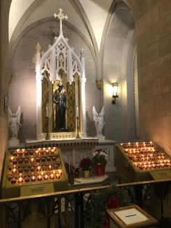 Devotion area of St. Patrick's Cathedral NYC with candles for lighting and statues for prayer