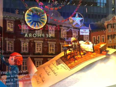 Macy's storefront window decorated for Christmas
