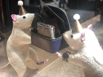 Merry mice playing with Coach purses window display NYC
