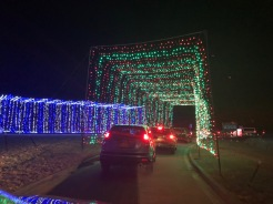 Holiday Magic of Lights at Jones Beach, NY Cars driving through a tunnel of lights