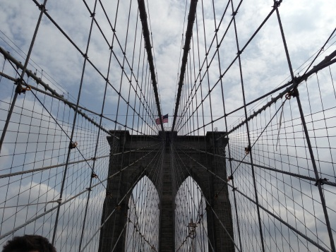 Looking up at the top of the Brooklyn Bridge through the support cables