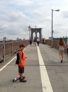 Boy with his scooter on the Brooklyn Bridge Pedestrian Walk