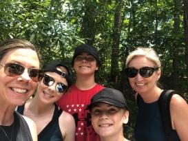 Five happy hikers smiling at Davidson-Arabia Nature Preserve, Georgia
