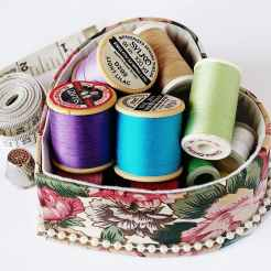 Spools of thread in a heart shaped box for organization