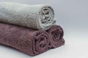 Three bath towels rolled for organization