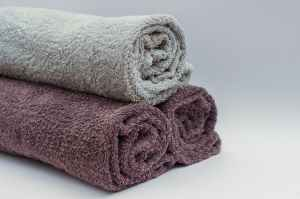 Three bath towels rolled for organization