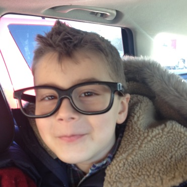 boy wearing large black glasses
