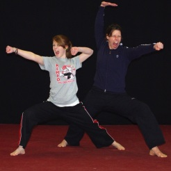 Mother and daughter martial arts pose