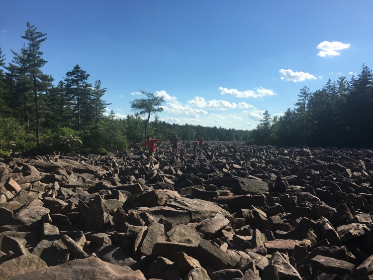 Kids running on the boulder field at Hickory Run State Park, Pennsylvania