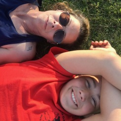 Mother and son laying on the lawn at Hickory Run State Park, Pennsylvania