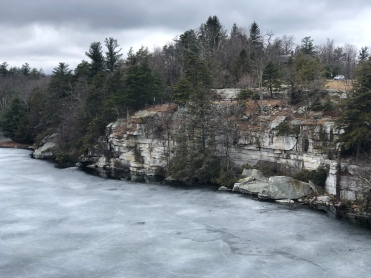 rocky edge of frozen Lake Minnewaska, New York