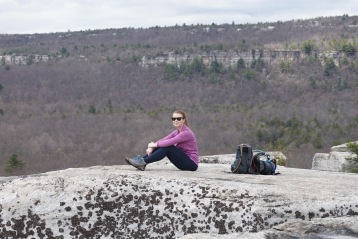 Woman sitting on Gertrude's Nose, Minnewaska Pereserve, New York
