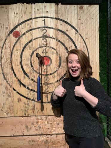 Thumbs -up at Kick Axe bullseye girl, Brooklyn, New York