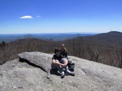 two posing on top of Split Rock with Blue Ridge Mountains, Grandfather Mountain, North Carolina