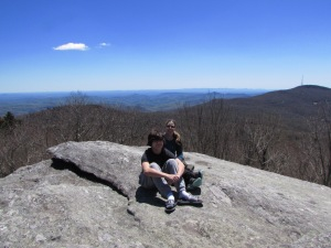 two posing on top of Split Rock with Blue Ridge Mountains, Grandfather Mountain, North Carolina