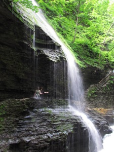 Standing behind Rainbow Falls at Watkins Glen State Park, New York