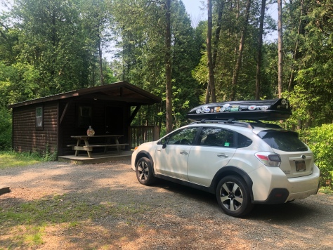 Subaru & rustic cabin at Watkins Glen State Park Site, New York