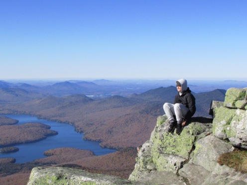 Sitting on the edge of Whiteface Mountain Summit, Adirondacks, New York